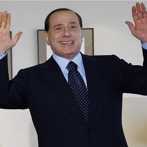 For once, Berlusconi puts his hands up for something