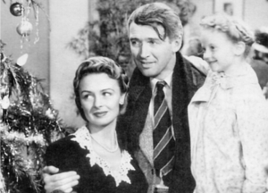 Karolyn Grimes played ZuZu Bailey (right), alongside Donna Reed and one James Stewart (plus a Christmas tree)