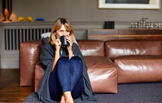 Woman on the floor drinking tea
