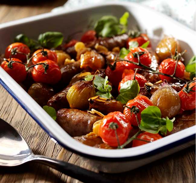Honey and soy-glazed roasted shallots and sausages