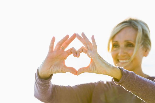 Women making a heart shape