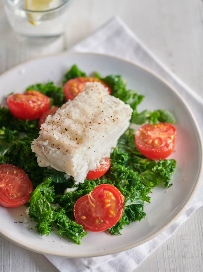 Halibut with kale and tomatoes in foil