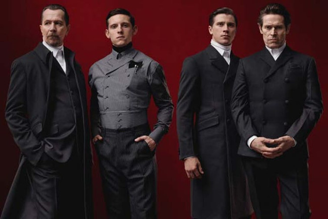 Distinguished cast: actors Gary Oldman, Garrett Hedlund, Jamie Bell and Willem Dafoe model Prada's Fall 2012 collection. Prada