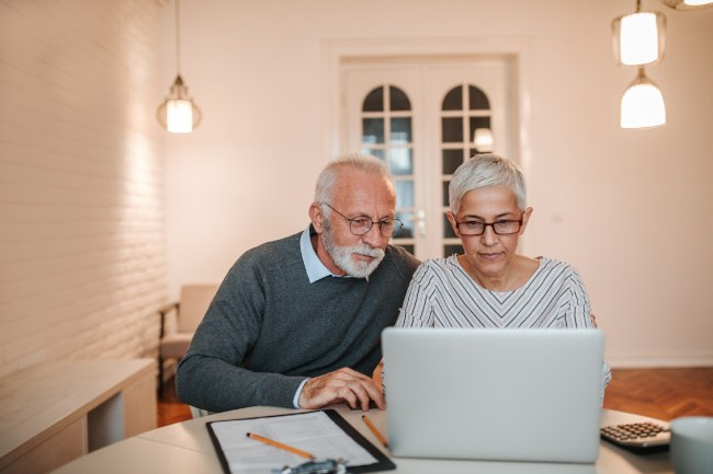 Older couple price checking