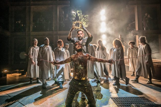 Cavin Cornwall and Nathan Amzi as Caiaphas and Annas and Company in Jesus Christ Superstar at the Barbican Theatre. Designer Tom Scutt; Lighting Design Lee Curran; Photo Johan Persson