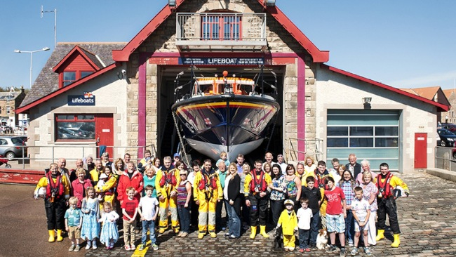 The Anstruther lifeboat community unites outside the lifeboat station. Credit: RNLI/Nigel Millard
